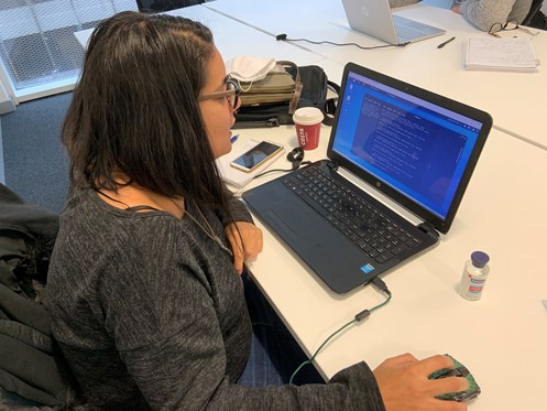 An image of a women working on her laptop