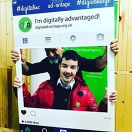 An image of a teenage with an older man holding a Instagram selfie frame that says I'm digitally advantaged on it