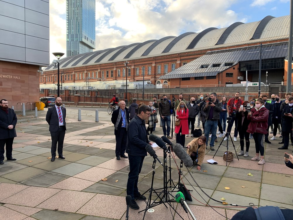 An image showing the Mayor Andy Burnham giving a press conference to media following talks with the Government